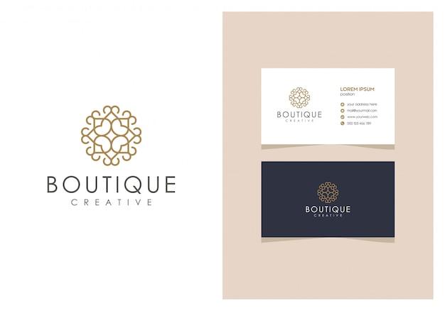 Logotipo de contorno de boutique natural con una tarjeta de visita