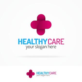 Logotipo de cuidado saludable con cruz.