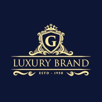 Logotipo decorativo floral monograma vintage de lujo dorado con plantilla de diseño de corona