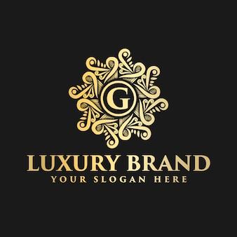 Logotipo decorativo floral monograma vintage de lujo dorado con plantilla de diseño de letra