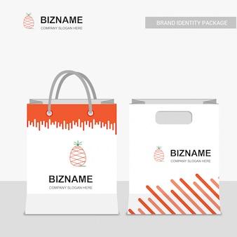 Logotipo de la empresa de frutas y bolso de compras