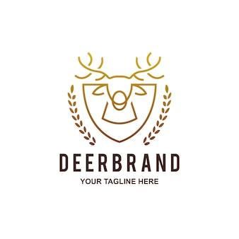 Logotipo de escudo de cabeza de ciervo dorado