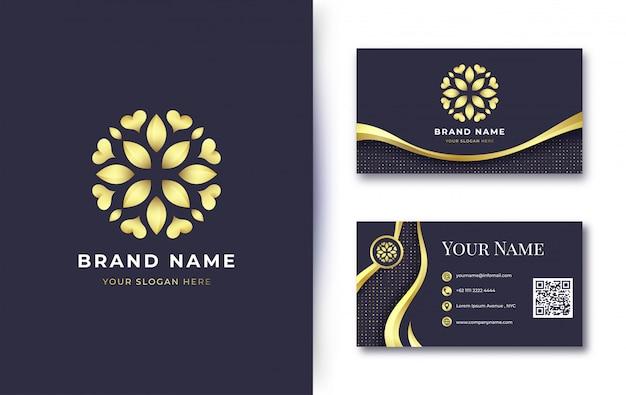 Logotipo de flor dorada de lujo con plantilla de tarjeta de visita