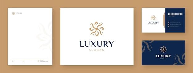 Logotipo de flor de lujo con tarjeta de visita y membrete
