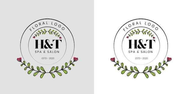 Logotipo floral de belleza femenina dibujado a mano con flores y hojas
