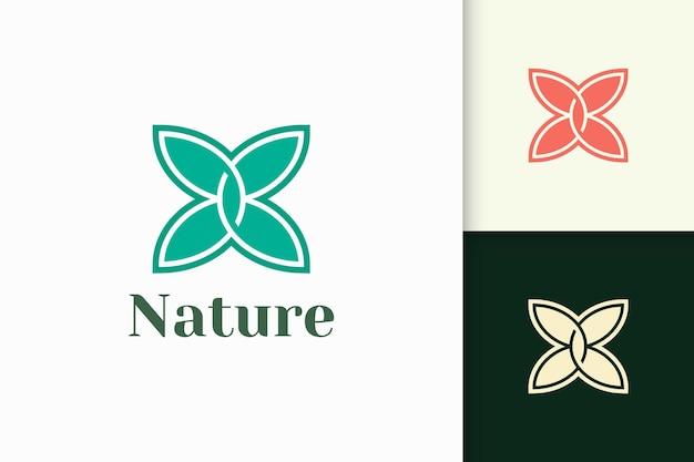 Logotipo de flores en estilo femenino y lujoso para la salud y la belleza.