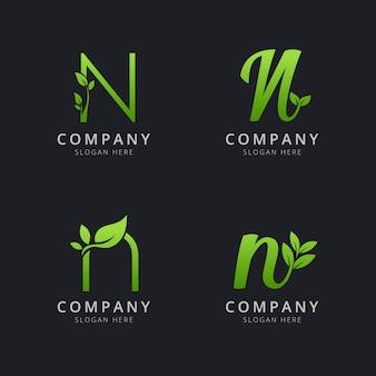 Logotipo inicial de n con elementos de hoja en color verde