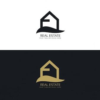 Logotipo inmobiliaria negro y dorado con una casa