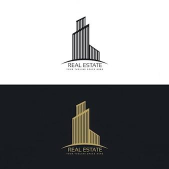 Logotipo inmobiliaria negro y dorado con un edificio