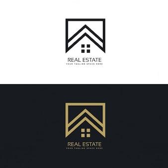 Logotipo inmobiliaria negro y dorado con un formas geométricas