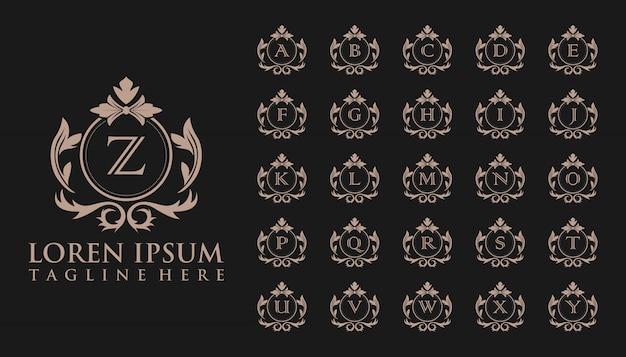 Logotipo de insignia inicial de lujo, plantilla