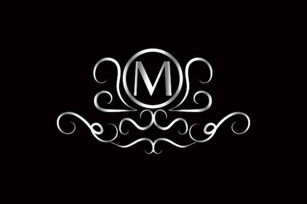 Logotipo de lujo moderno letra m con adornos dorados