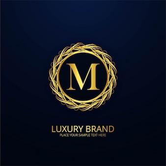 Logotipo de lujo ornamental de la letra m