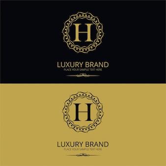 Logotipo de marca de lujo de la letra h
