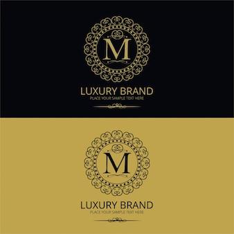 Logotipo de marca de lujo de la letra m