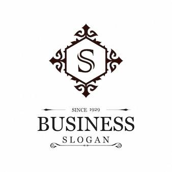 Logotipo con un marco ornamental y la letra s