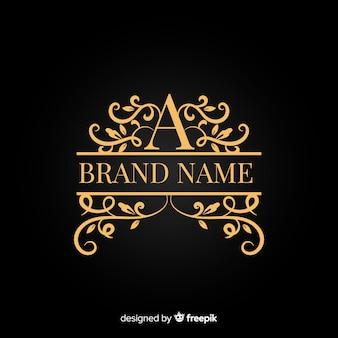 Logotipo ornamental de la elegante empresa dorada