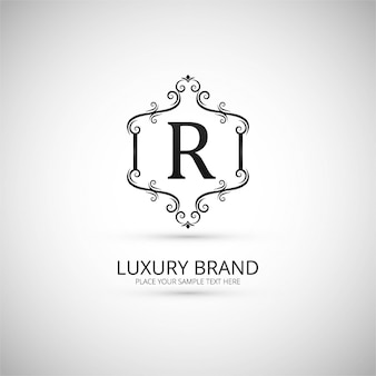 Logotipo ornamental de la letra r