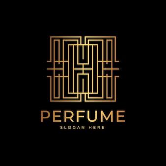 Logotipo de perfume de lujo y estilo dorado