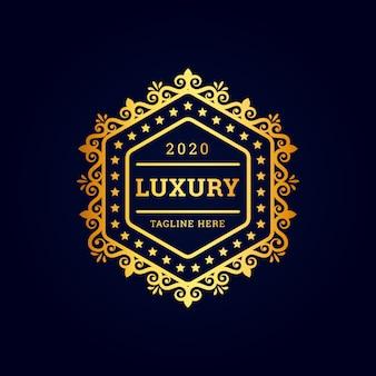 Logotipo premium hexagonal de lujo vintage con dorado