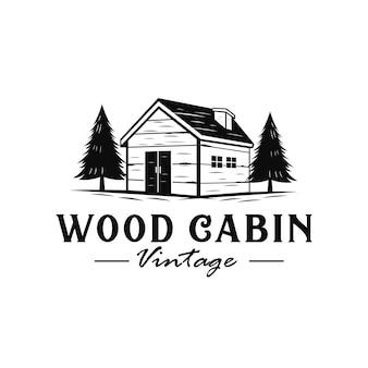 Logotipo vintage de cabina de madera con estilo dibujado a mano