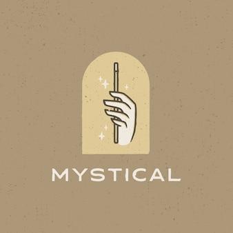 Logotipo vintage de varita mágica de mano mística