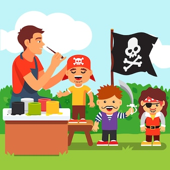 Los niños piratean la pintura de la cara en el jardín de infancia
