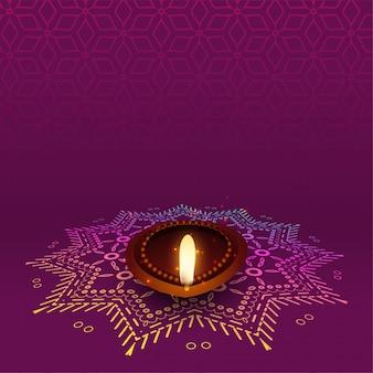 Lovely diwali diya con diseño rangoli
