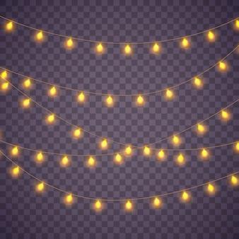 Luces amarillas aislaron elementos realistas sobre fondo transparente. conjunto de guirnalda de oro brillante de navidad. luces para el diseño de la tarjeta de felicitación de navidad. guirnaldas, decoraciones para fiestas.