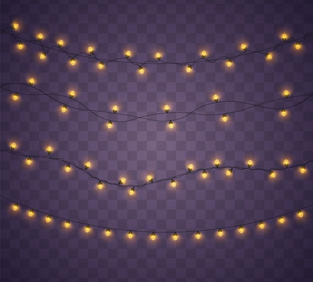 Las luces amarillas de navidad aislaron elementos realistas. luces de navidad