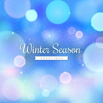 Luces borrosas con texto de invierno