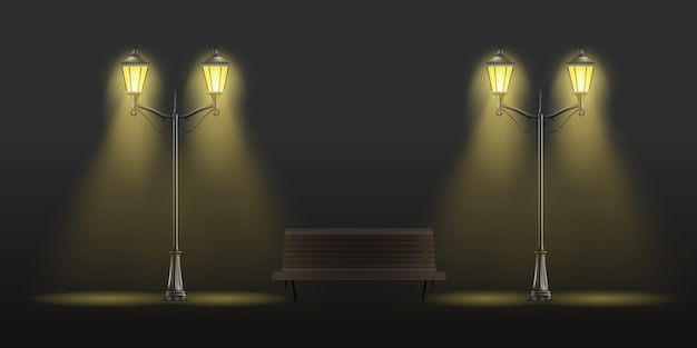Luces de calle vintage brillando con luz amarilla y banco de madera