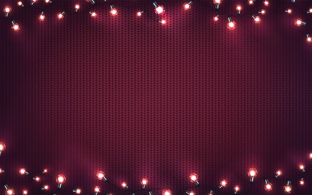 Luces de navidad. guirnaldas brillantes de navidad de bombillas led en textura de punto morado. fondo de vacaciones