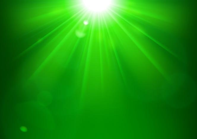 Luces verdes que brillan con destello de lente