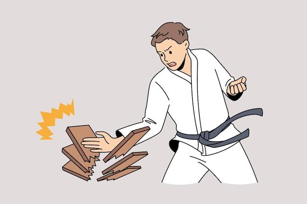 Luchas orientales y concepto de arte de guerra. hombre joven en kimono blanco de pie haciendo empuje con la mano rompiendo maderas sintiéndose fuerte ilustración vectorial segura