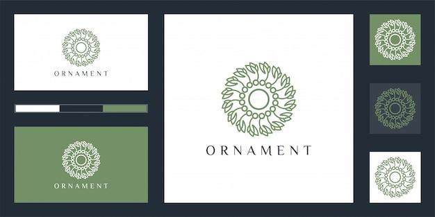 Lujoso logotipo de diseño de adornos que inspira.