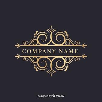 Lujoso logotipo ornamental con el nombre de la empresa.