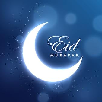 Luna brillosa creciente para el festival de eid mubarak sobre fondo azul