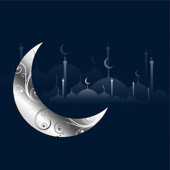 Luna decorativa plateada y mezquita islámica.