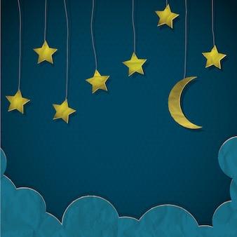 Luna y estrellas hechas de papel.