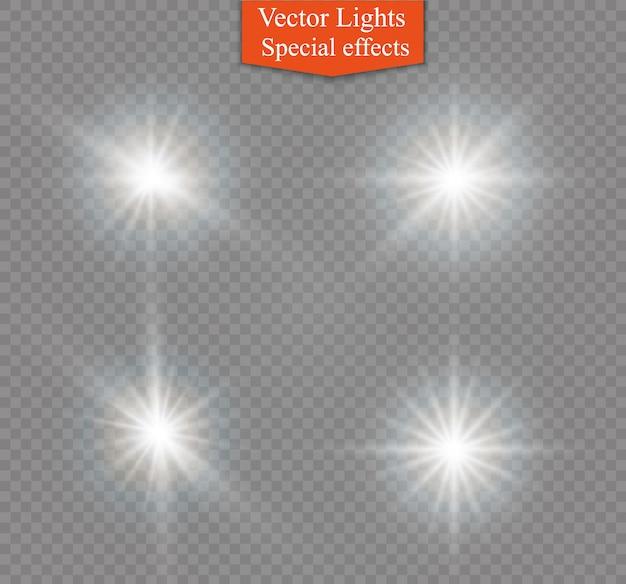 La luz blanca brillante explota sobre un fondo transparente. brillantes partículas de polvo mágico. lucero. sol brillante transparente, destello brillante. destellos