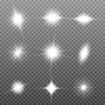La luz blanca brillante explota sobre un fondo transparente. partículas de polvo mágico espumoso. conjunto de estrella brillante. sol brillante transparente, destellos brillantes para centrar un destello brillante