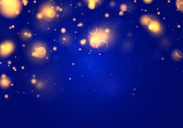 Luz de bokeh borrosa sobre fondo azul oscuro. brillo abstracto desenfocado chispas.