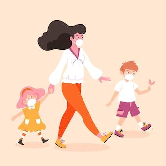 Madre caminando con niños con máscaras médicas