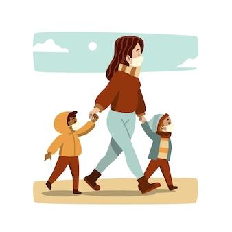 Madre caminando con sus hijos con máscaras médicas