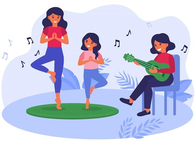 Madre e hija practicando yoga con música acústica