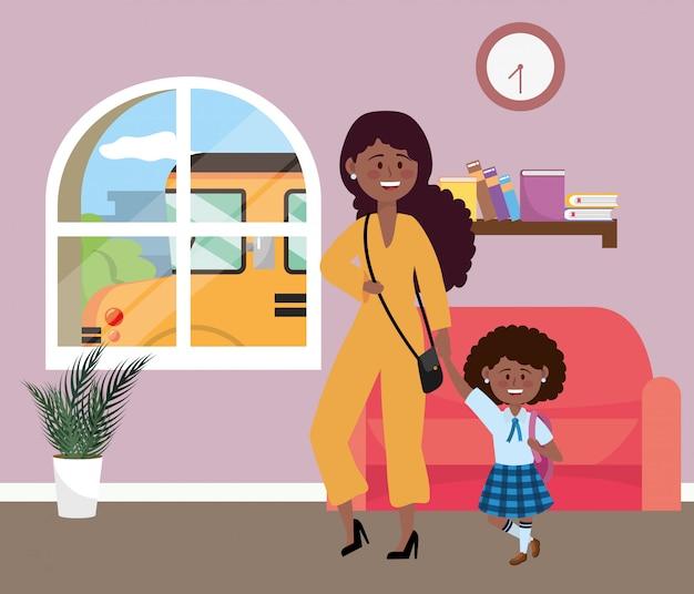Madre e hija van a la escuela