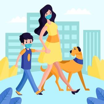 Madre con niño y su perro paseando por el parque