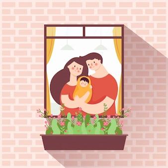Madre y padre abrazando bebe
