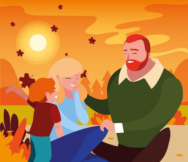 Madre y padre con hijo en otoño